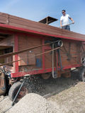 Farmer on old vintage wheat thresher in holland Royalty Free Stock Photo