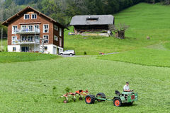 Free Farmer On His Tractor Royalty Free Stock Images - 60237489