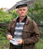 The farmer with a pack of money Stock Photos