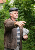 The farmer with a pack of money Royalty Free Stock Photos