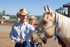 Farmer Pets Hose - horizontal Stock Images