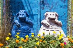Farmer Pigs in Flower Garden Stock Image