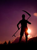 Farmer with pitchfork. Silhouette man with pitchfork at sunset stock photos