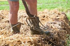 Farmer with pitchfork and boots Stock Images