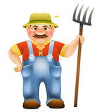 Farmer with a pitchfork Royalty Free Stock Photo