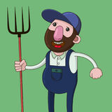 Farmer with pitchfork Stock Photography