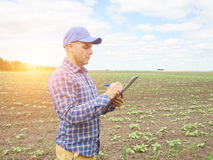 Farmer in a plaid shirt controlled his field. Royalty Free Stock Photography