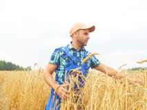 Farmer in a plaid shirt controlled his field. Stock Photography