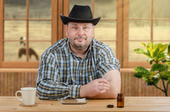 Farmer in plaid shirt holds syringe for injection Royalty Free Stock Image