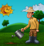 The farmer and the plant. Young farmer is sprinkle a little plant Royalty Free Stock Photo