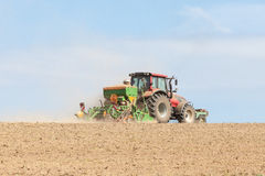 Farmer planting crops with a planter with a large hopper, skylin Stock Photos