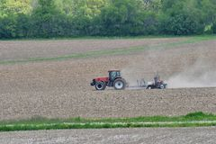 Farmer planting field in the spring Stock Photos