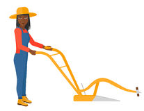 Farmer with plough. An african-american farmer using a plough vector flat design illustration isolated on white background Royalty Free Stock Images