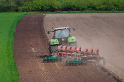 Farmer ploughing field Royalty Free Stock Photos