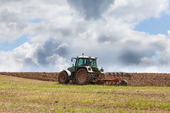 Farmer ploughing an overwintered field ready for planting Stock Image