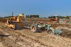 Farmer plowing the field with an old crawler tractor Fiat Royalty Free Stock Photos