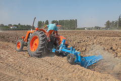 Farmer plowing the field with an old tractor Fiat 80 R Royalty Free Stock Images