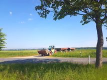 farmer is plowing a field with Tractor royalty free stock images