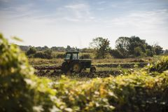 Tractor plowing Royalty Free Stock Photos