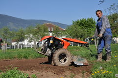 Farmer plowing the ground Stock Photography