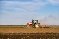 Farmer plowing stubble field royalty free stock photos