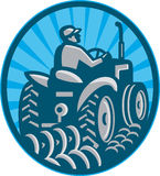 Farmer Plowing With Tractor Retro Stock Photo