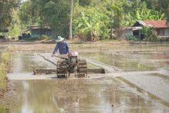 Farmer plowman using tiller tractor Stock Photos