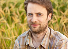 Farmer portrait in front of his wheat field Royalty Free Stock Photos