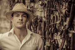 Farmer Portrait in front of a Wall Full of Tools Stock Photos