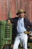 Farmer Portrait with Tractor. Farmer pauses for a portrait with his tractor Royalty Free Stock Image