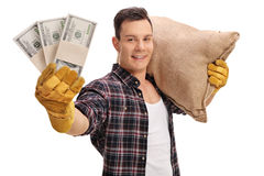 Farmer posing with burlap sack and money bundles Stock Photography