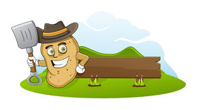 Farmer Potato. Is standing up on his farm, holding scoop in his hand. and there is a blank board behind him Stock Images