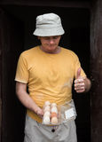 Farmer in the poultry yard. Farmer holding fresh organic eggs. Poultry yard Royalty Free Stock Photo