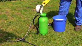 Farmer prepare pesticides chemicals for plant spray stock footage