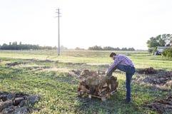 Farmer. Prepares himself to the long work day Stock Photos