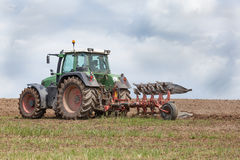 Farmer preparing a field for planting - ploughing Stock Images