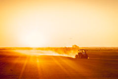 Farmer preparing his field in a tractor ready for spring Royalty Free Stock Photo