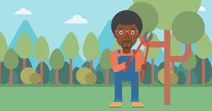 Farmer with pruner in garden. An african-american man holding a pruner on a background of garden with trees vector flat design illustration. Horizontal layout Royalty Free Stock Images