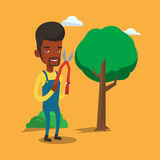 Farmer with pruner in garden vector illustration. Royalty Free Stock Image