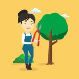 Farmer with pruner in garden vector illustration. Royalty Free Stock Images