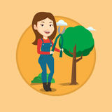 Farmer with pruner in garden vector illustration. Royalty Free Stock Photo
