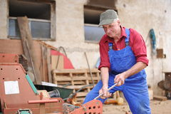 Farmer repairing his red tractor Royalty Free Stock Photos