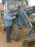 Farmer repairing tractor 2 Royalty Free Stock Photos