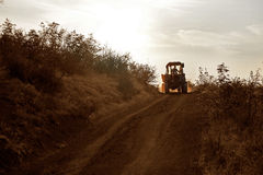 Farmer rides on the tractor Stock Images