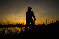 Farmer riding bicycle Stock Images