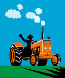 Farmer riding a tractor Stock Images
