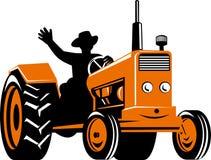 Farmer riding a tractor Stock Photo