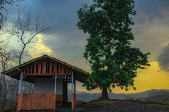 The farmer`s cottage and the color of the sky. Farmer huts are used as a resting place for farmers in the Central Java highlands in Indonesia. a good time to sit royalty free stock images