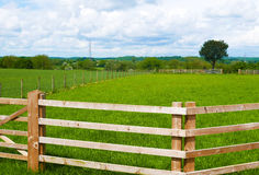 Farmer's fence around field Stock Image