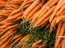 Farmer's Market Carrots. A stack of fresh carrot bunches at the Clement Street Farmer's Market in San Francisco Stock Images